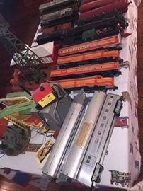 so many trains including the orange Lionel Southern Pacific Engine 8150 and S. Pacific Daylight Cars