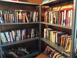 Plenty of fiction and non-fiction books! One whole shelf of John Grisham