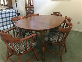 Dining table and 6 chairs.  Table is shown with a large leaf