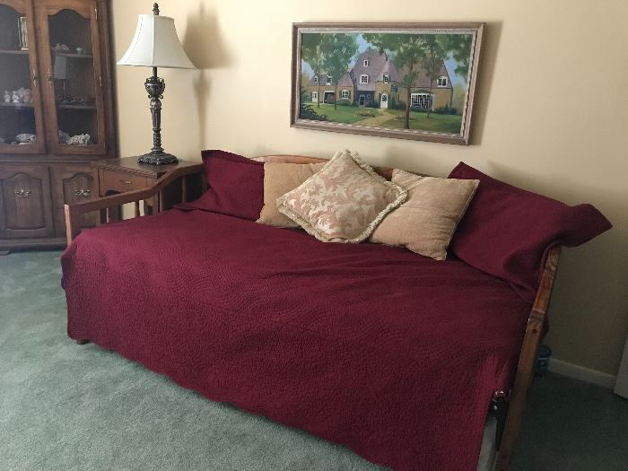 Trundle bed.  There are several sets of bedding .