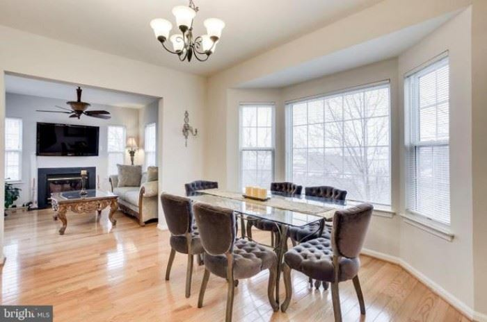 Glass top dining table with 6-velvet chairs
