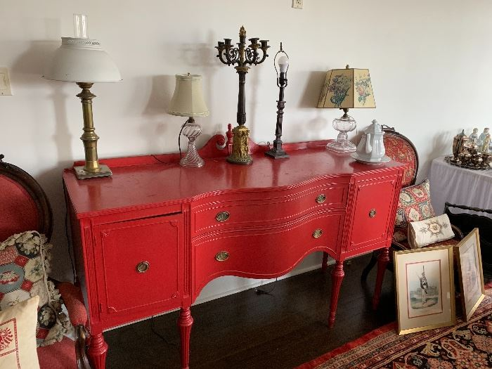 Eclectic painted furniture pieces and antique lamps