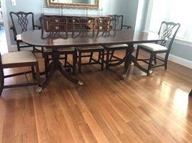 """Table measures 46"""" wide and 6' long with no leaves. It comes with 3 leaves that are each 20"""". 2 captains chairs. 6 dining chairs"""