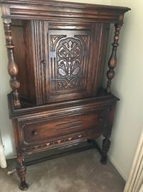 Original finish with carved front opening door and large single drawer!