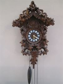 Cuckoo Clock, Black Forest with Unusual Scroll Leaf Carvings.  Antique Baroque Style