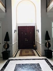 Topiary trees + entry rug