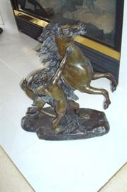 One of a pair antique Marly Roman themed bronzes or bronzed spelter figures with horse and groom. These sculptures came from France, are unsigned and were previously owned by the owner's grandfather. Dates to early 1900.