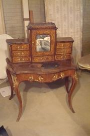 Fine 19th century Louis XV French marquetry inlaid  Ladies writing desk with bronze ormolu mounts and pulls.