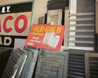 old wooden shutters & Old Gold sign