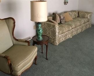 VINTAGE SOFA, WALL SCONCES, WING CHAIR, SIDE TABLE, LAMP