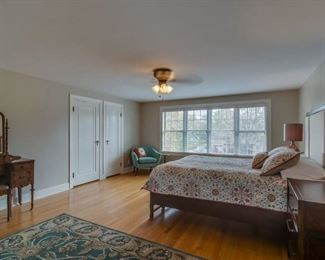 5 x 8 wool rug, antique vanity, queen bed, bedding and lighting