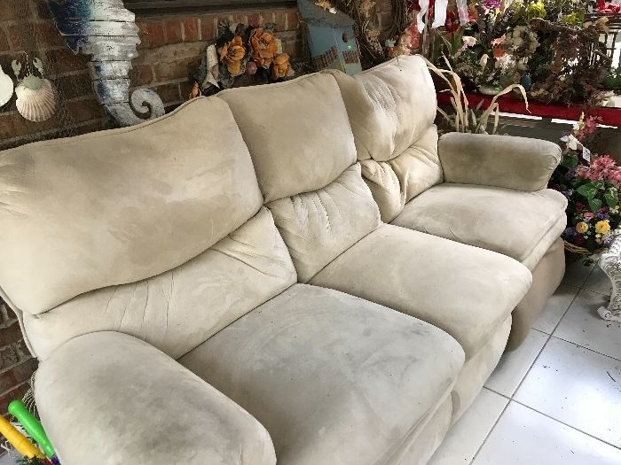 Reclining Sofa (needs cleaning) priced accordingly