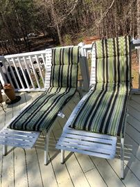 Two lounging chairs with cushions