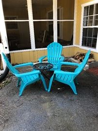 Blue plastic Adirondack style chairs and table