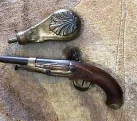 """Flint Lock, French Military, 19th century.   This flint lock pistol has been in family for generations.                       Power flask  """"Shell and Bush""""design."""