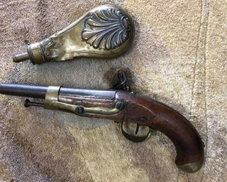 "Flint Lock, French Military, 19th century.   This flint lock pistol has been in family for generations.                       Power flask  ""Shell and Bush""design."