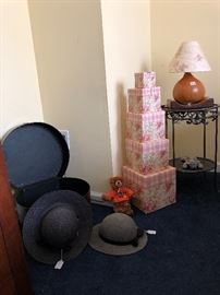 Hats, boxes,  metal table and gourd lamp