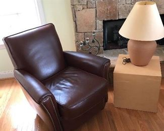 Comfortable chair, table and pottery lamp