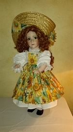 All porcelain red hair blue eyes - $25                                    Hand made clothing by famous St. Louis, MO Artist