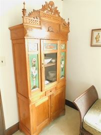 Ornate cupboard with painted glass panels