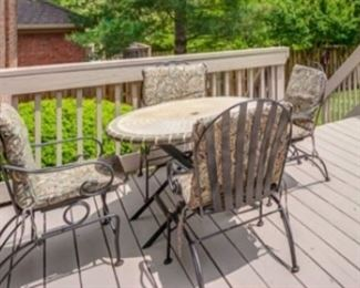Wrought iron patio furniture with 6 spring chairs