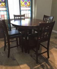 "42""' round high top table with 4 chairs"