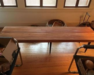 1960s original 12 slat bench with black tapered legs $675 firm