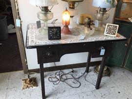 Enamel top desk, vintage Westclox alarm clocks, Aladdin Lincoln drape shelf lamp, Pink bedside lamp
