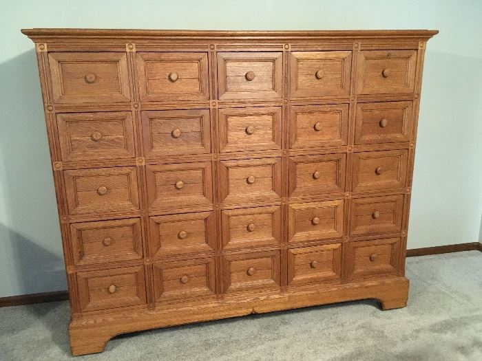 "Large American oak filing cabinet. 25 panel drawers from early 1900's. 62"" tall"
