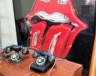 Enormous Rolling Stones Lips Neon Sign and Vintage Telephones