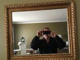 a large beveled-mirror -- goofy guy in the picture free to good home!