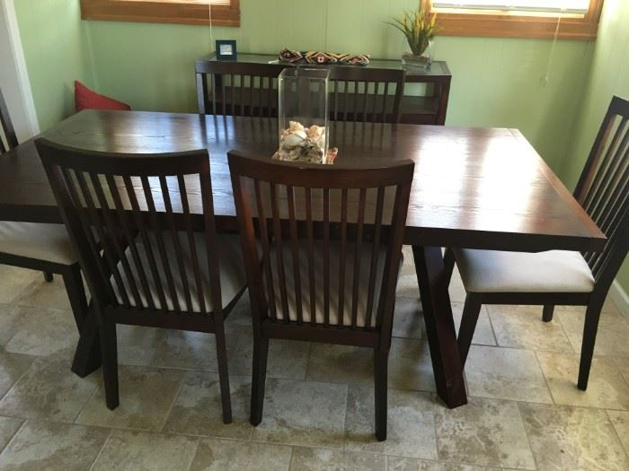 A beautiful dining table and chairs -- solid -- serious buyers only!