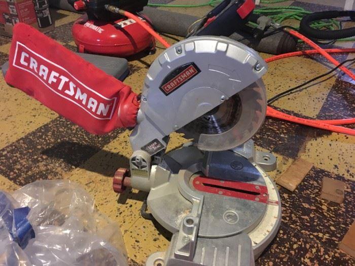 A nearly new Craftsman miter saw.