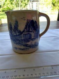 Vintage Paul Storie blue on cream pottery pitcher https://ctbids.com/#!/description/share/132512