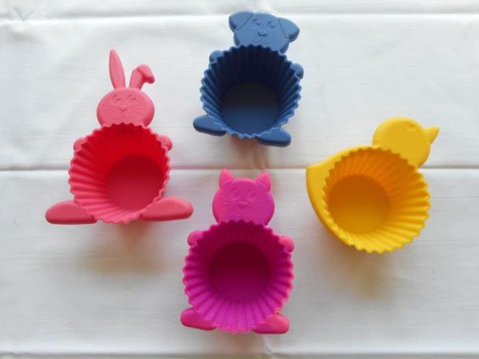 "4 Spring silicon cupcake molds - 2 1/2"" dia https://ctbids.com/#!/description/share/132926"
