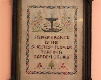 Framed vintage cross-stitched textile.