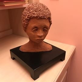 "Red clay sculpture titled ""Minnie"" by Louise Manguson. Minnie, the family's African American maid, is lovingly represented in this piece."