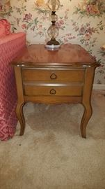 We have two mid century side tables Bassett furniture