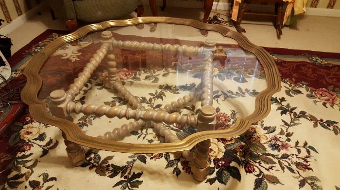 Glass top coffee table with wooden base