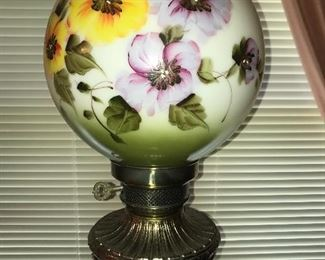 Tall vintage lamp with hand painted floral pansies globe.