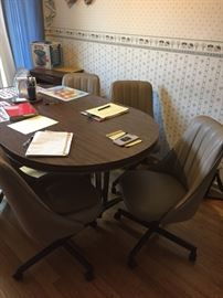 Kitchen table with rolling chairs