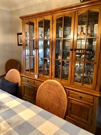 Oak dining room table, 8 chairs & china cabinet. Lots of china & collectibles