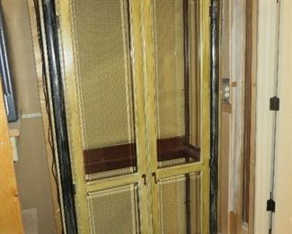 """ETHAN ALLEN """"EMPIRE"""" CURIO  WITH ARCHED DOORS   LIGHTED INTERIOR WITH GLASS SHELVING  PAINTED IN GOLD WITH  BLACK ACCENTS"""