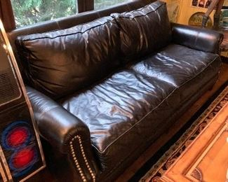 Fine leather sofa - matching chair and ottoman available.