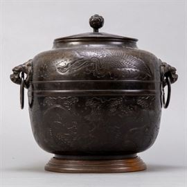 An excellent Japanese Meiji bronze container with lovely deep red patina. In an oval form. Surfaces bear incised dragon and phoenix motifs. Likely an element of the tea ceremony. Dimensions: Height: 12 in.