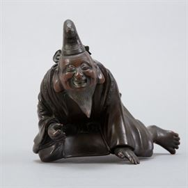 A Japanese bronze sculpture of a laughing immortal. Likely a piece of a larger sculpture. Dimensions: Height: 5 in x width: 6 1/4 in x depth: 5 1/4 in.