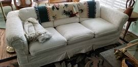 Slip covered cream colored sofa, excellent condition - very clean.