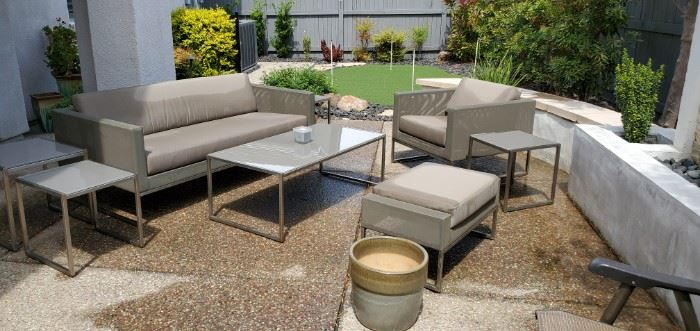 Crate and Barrel Dune Light Gray Sofa, 4 nesting tables, coffee table, lounge chair and Ottoman.  8 Piece patio furniture. Purchased 3.5 years ago for $4,600.00 selling for $2,200.00