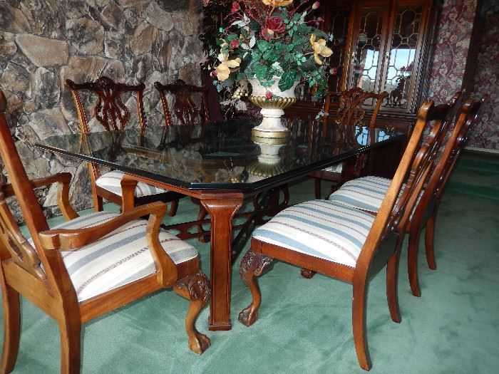 Thomasville Glass top table with 6 chairs ,carved claw and ball feet.