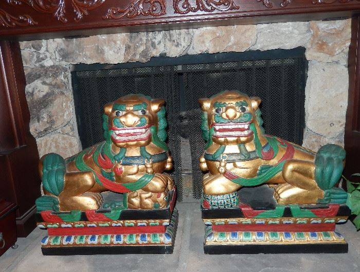 Large wood carved dogs